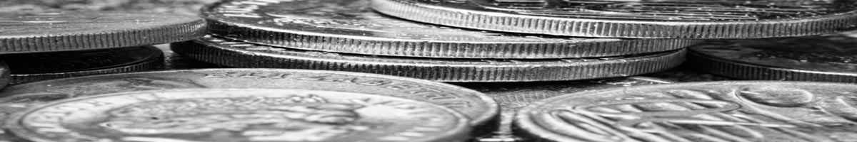 Close up of various coins in black and white.